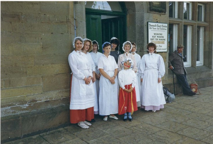 Group in period costume outside the old Jail house, Dornoch