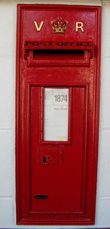 Royal Mail wall mounted postbox with VR insignia