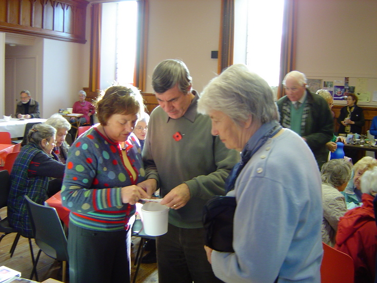 Cliff Reddin and helpers drawing the raffle