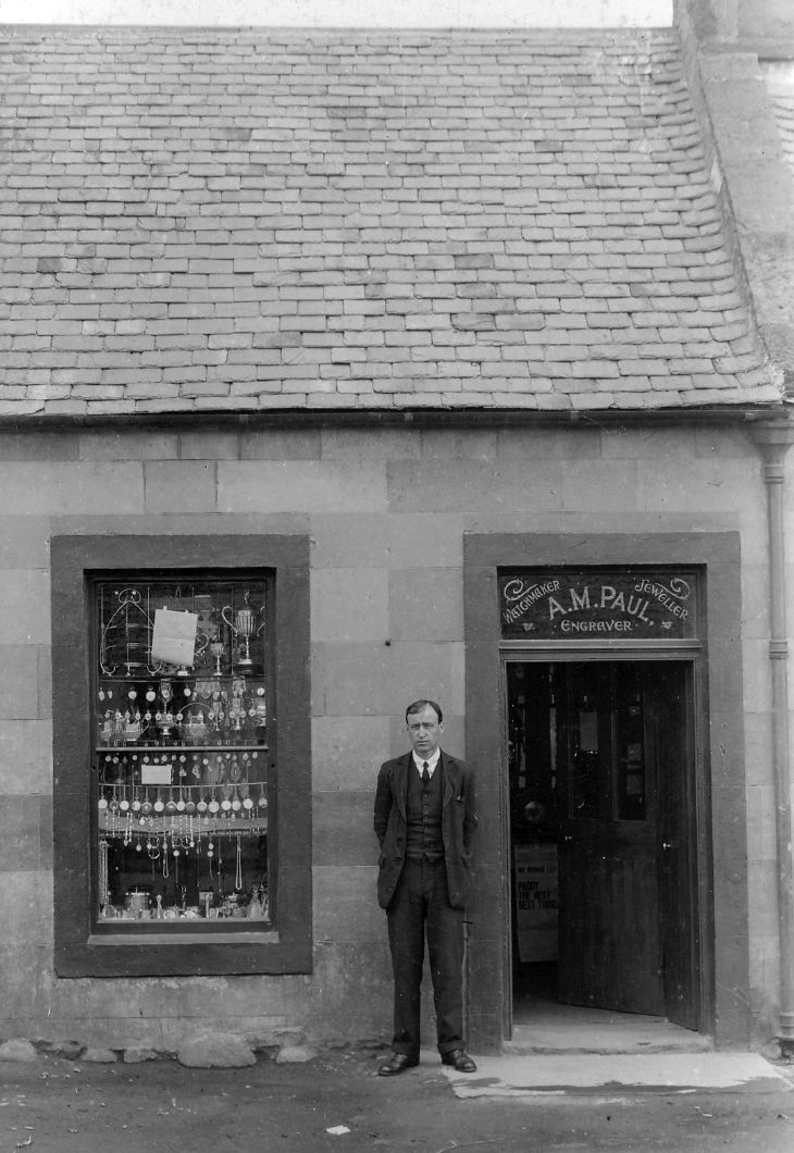 Photograph of Mr Paul outside his shop in Golspie.