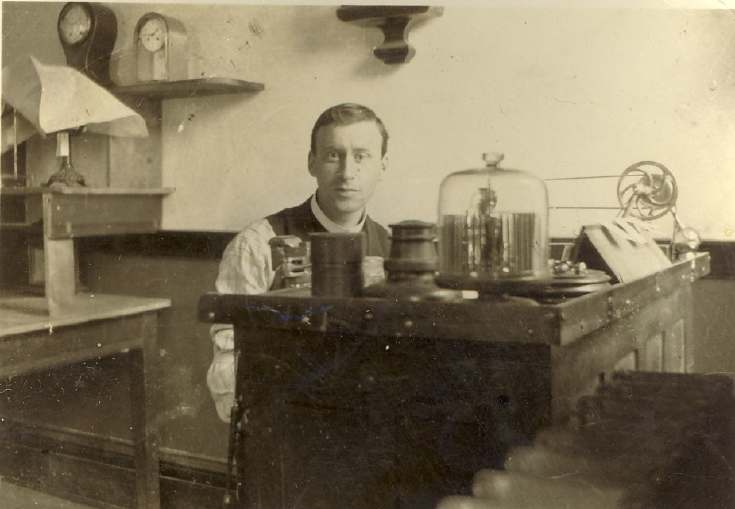 Photograph of Mr Paul at his work bench.