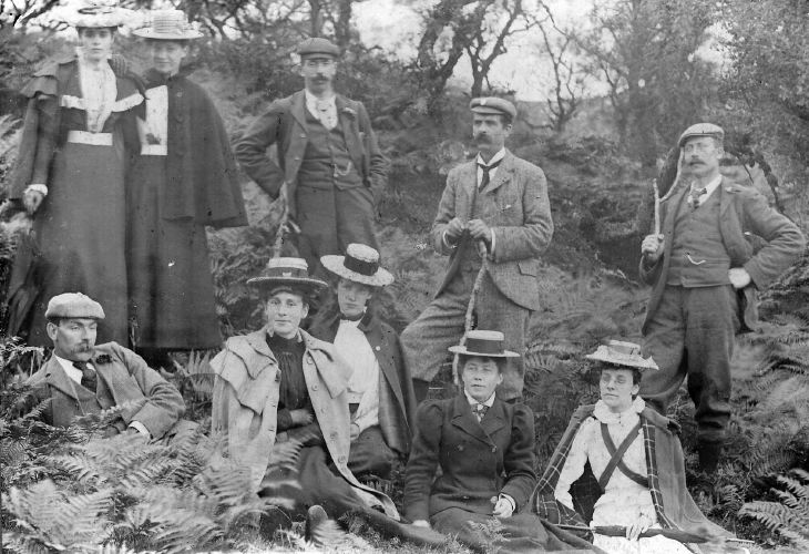 photograph showing party of 6 women and 4 men in wooded area