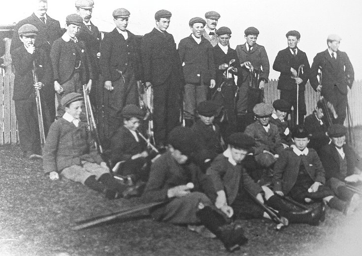Group of caddies and golfers