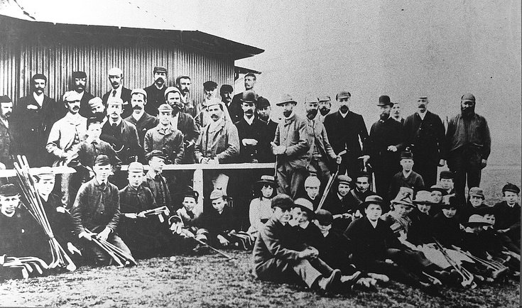 Group of caddies and golfers c 1905