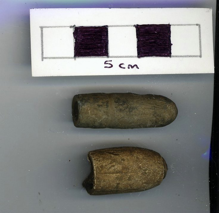 Objects discovered on Pitgrudy Farm - two pistol bullets