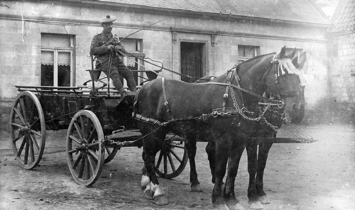 John Gordon driving a cart