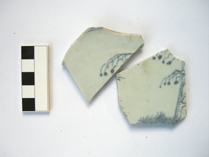 Vitrified pale blue ceramic pottery fragments with blue pattern