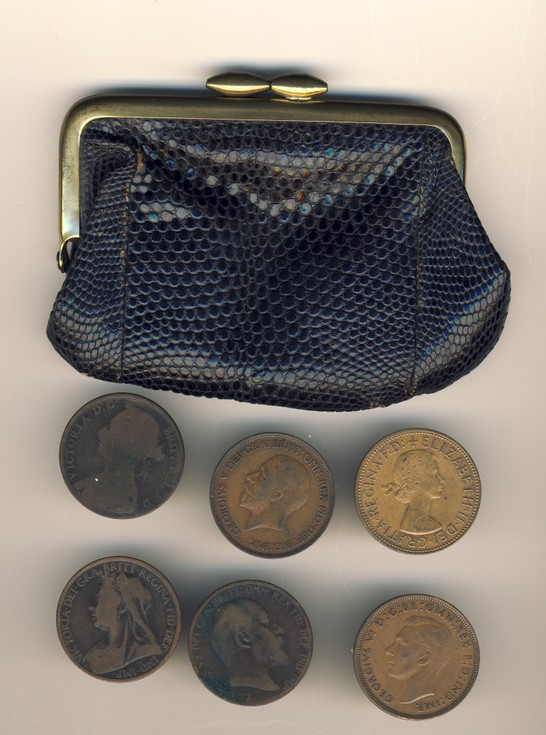 Various 1d coins in a black purse