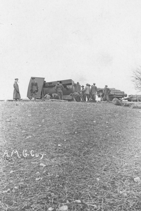 CFC troops inspecting an overturned railway locomo