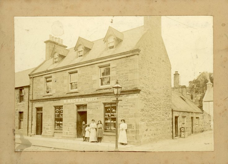 W. Macrae's shop with a family group and staff?