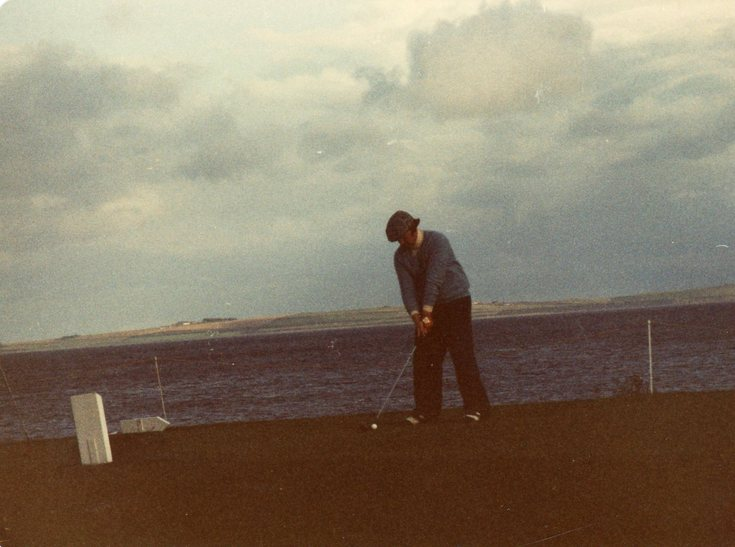 Teeing off against a Dornoch Firth backcloth