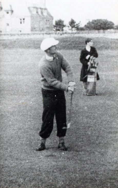 Golfer and caddie
