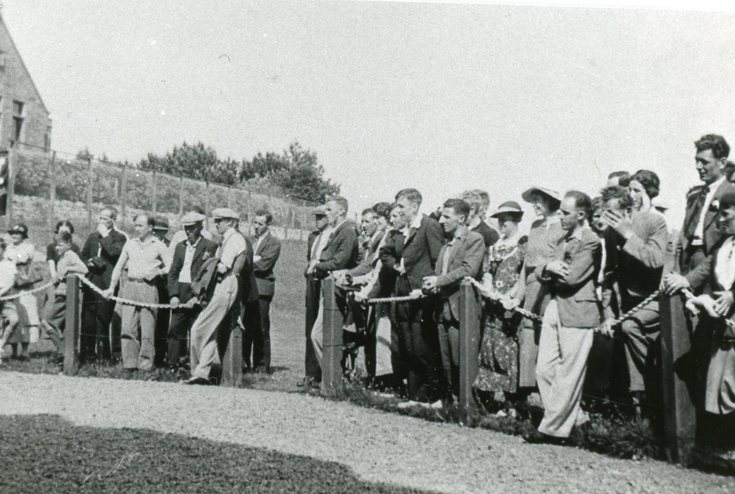 Spectators at the clubhouse
