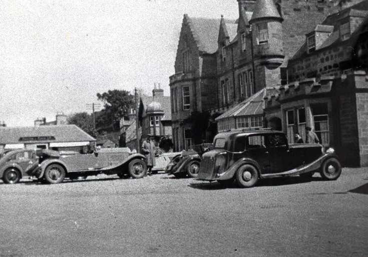 An assembly of cars at the Sutherland Arms Hotel