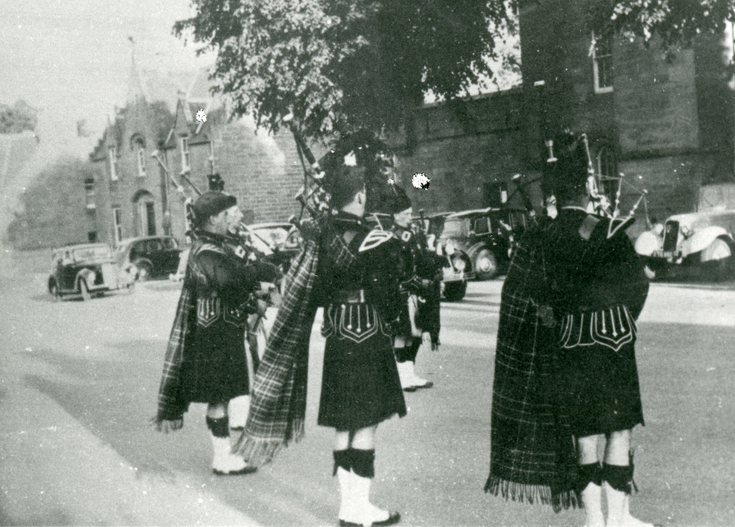 Pipers in Dornoch Square  c 1950