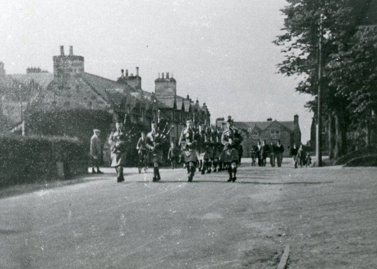 Pipers leading a detachment of troops