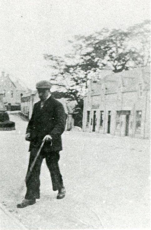 Gentleman with cane in High Street, Dornoch