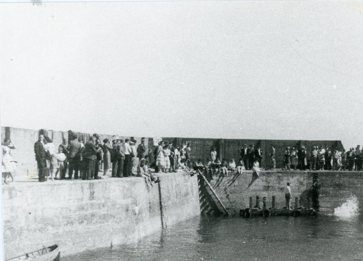 A crowd gathered at Embo Pier
