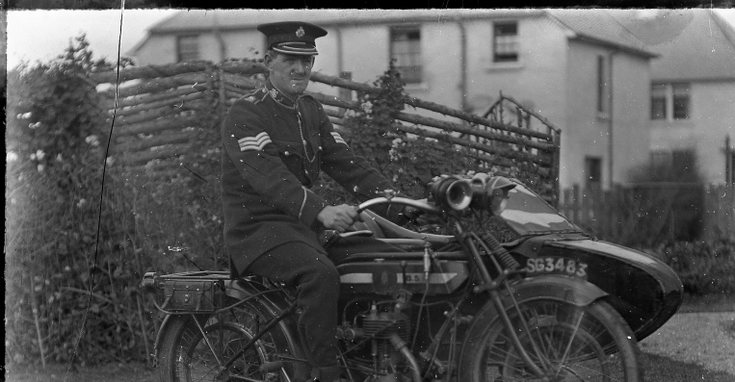 Police Sergeant on motorcyle with sidecar