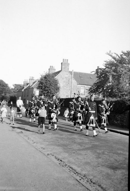 Dornoch Pipe Band accompanied by children