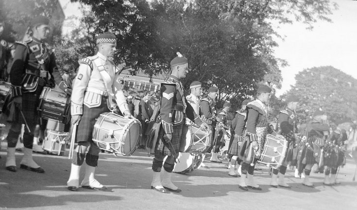 Dornoch Pipe Band standing at ease