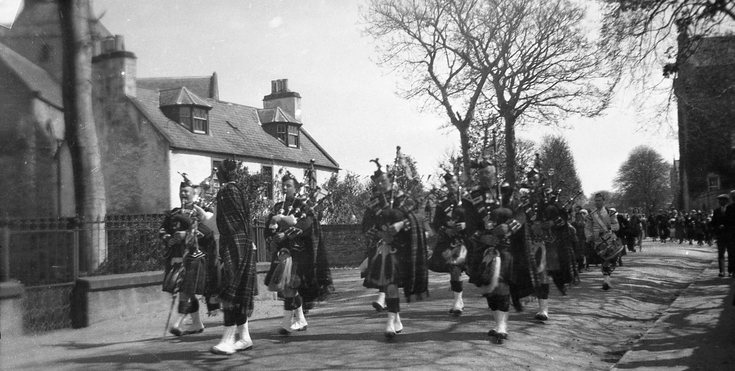 Dornoch Pipe Band marching out of the Square