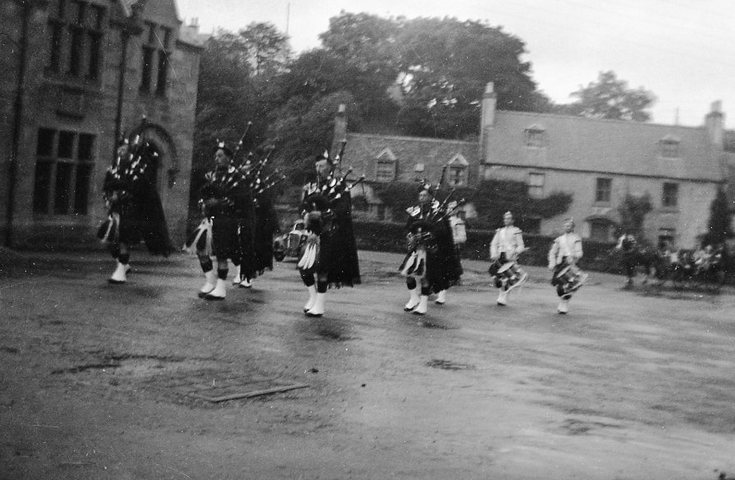 Dornoch Pipe Band entering High Street