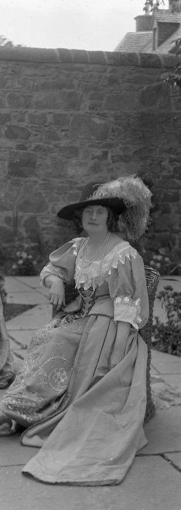 1928 Pageant Costume lady sitting in Castle garden