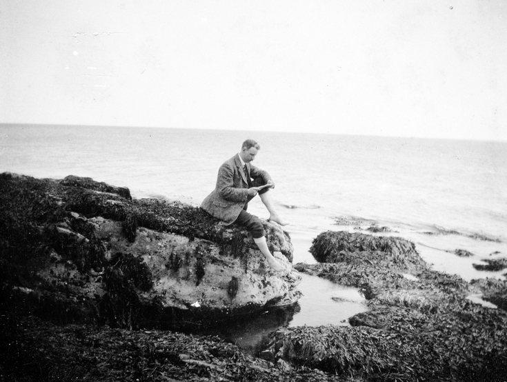 Gentleman sitting on the rocks at Dornoch beach