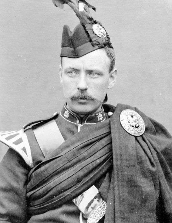 Studio photograph of soldier in full dress uniform