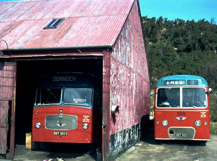 Two single deck buses at Dornoch Bus Garage
