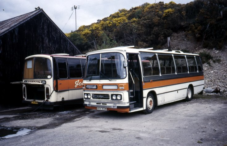 Two 1974 registration single deck buses at Dornoch