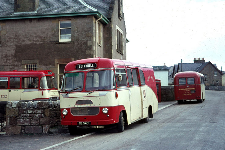Mail buses in red and white livery at Lairg Post O