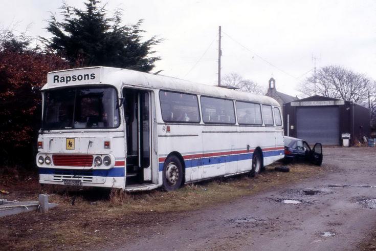 R G H Rapson coach parked at Brora