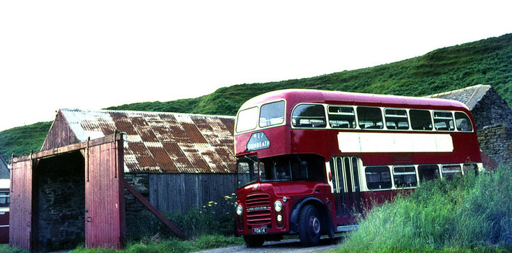 Double deck Highland bus at the garage in Dunbeath