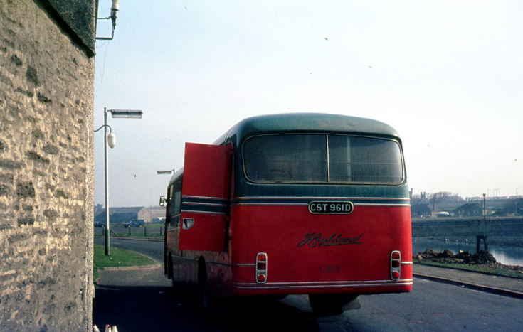 Rear view of Highland mail bus in Thurso