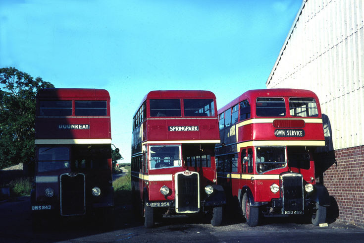 Three Highland double deck buses in Thurso garage
