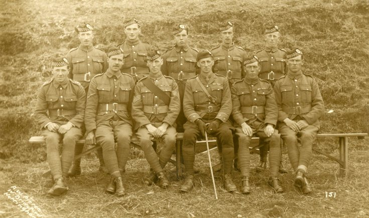 Group photograph of an officer and his platoon