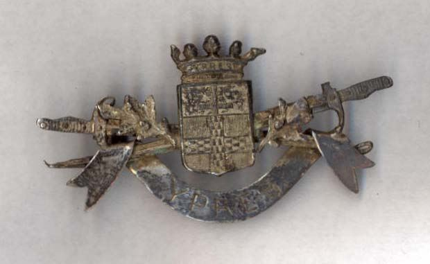 Small metal brooch with scroll inscription Ypres
