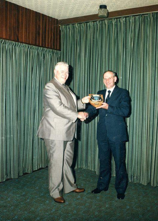 John Jappy receiving shield presented on retiremen