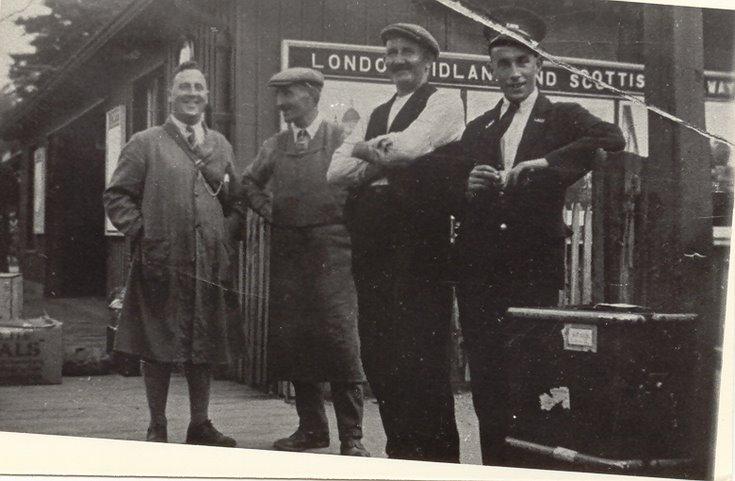 Group of railwaymen at Dornoch station