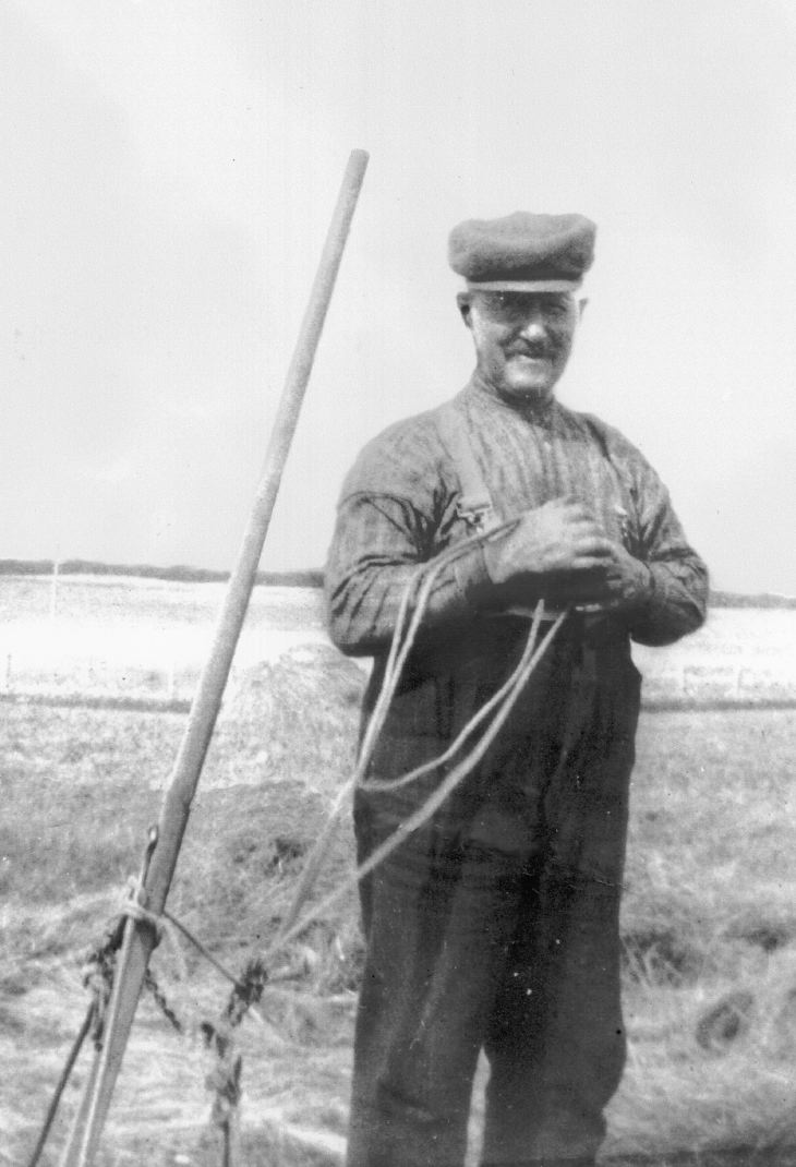 Photograph of Billy MacKenzie with hand operated hay rake.
