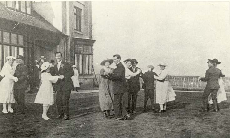 Photograph of group of dancers outside Briarfield.