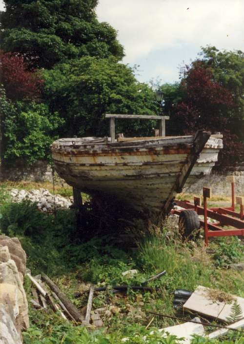 Old ferry boat behind cathedral