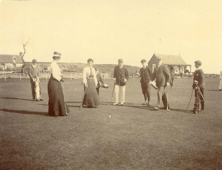 Golfers on the 18th hole of the ladies' course