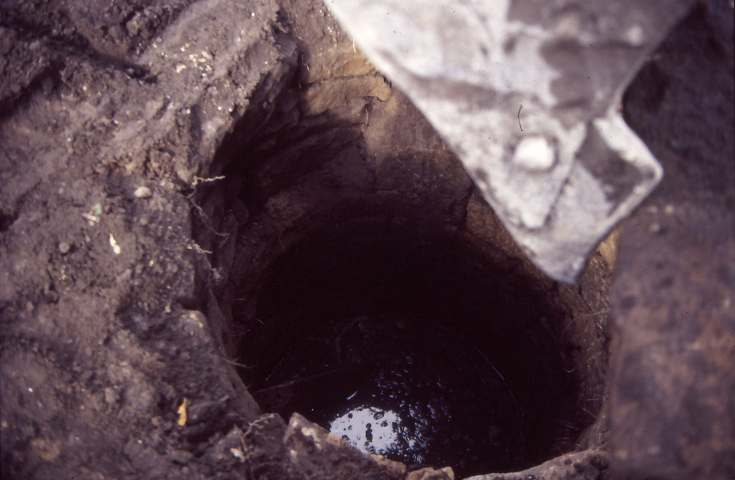 Uncovering well at old manse 1987