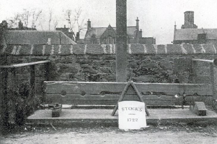 Photograph of Mercat Cross and Stocks