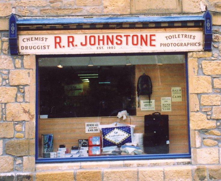 Close up of pre 2002 R R Johnstone Chemist Shop sign, Dornoch