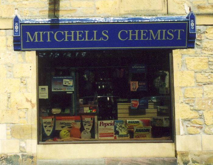Close up of post 2002 Mitchell's Chemist Shop sign, Dornoch