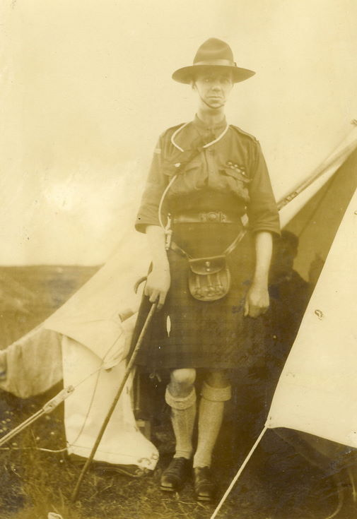 Scout leader standing in door of a bell tent